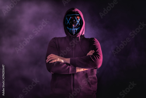 A man in a mask surrounded by smoke in a old building Wallpaper Mural