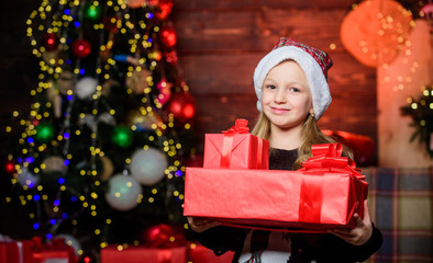 All the gift packs brought by Santa Claus. Happy little girl holding gift boxes on boxing day. Small child getting Christmas or new year gift. Adorable kid carrying beautifully wrapped gift boxes