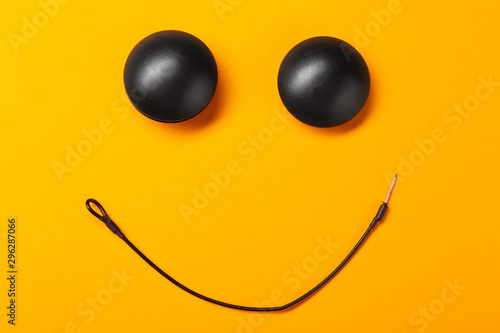Photo on a yellow background smiley from anti-theft magnetic clips, business security