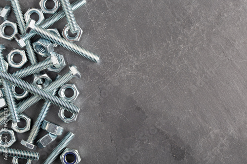 Nuts and bolts steel metal on slate base Wallpaper Mural