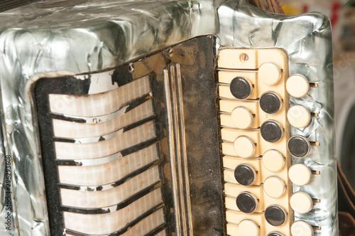 Fényképezés  The old rare accordion buttons close up view.