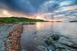 Leinwandbild Motiv Dramatic sunset over Scourie in the Highlands of Scotland