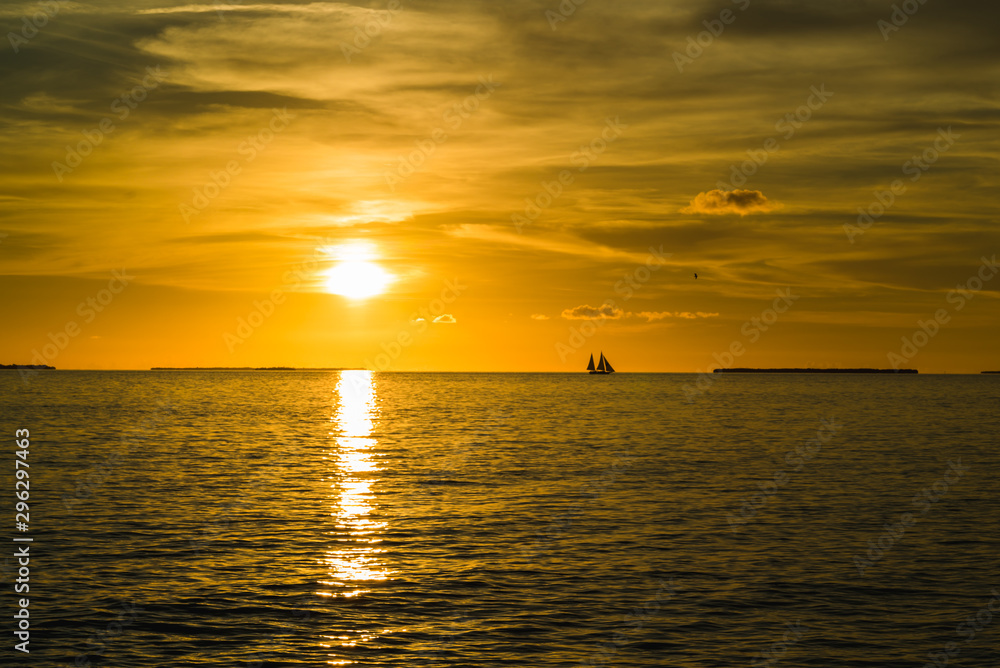 Colorful orange beautiful sunset on sea summer background. Hot and romantic sunset over the ocean. Calm landscape.