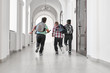 canvas print picture - Group of schoolboys with school backpacks running.