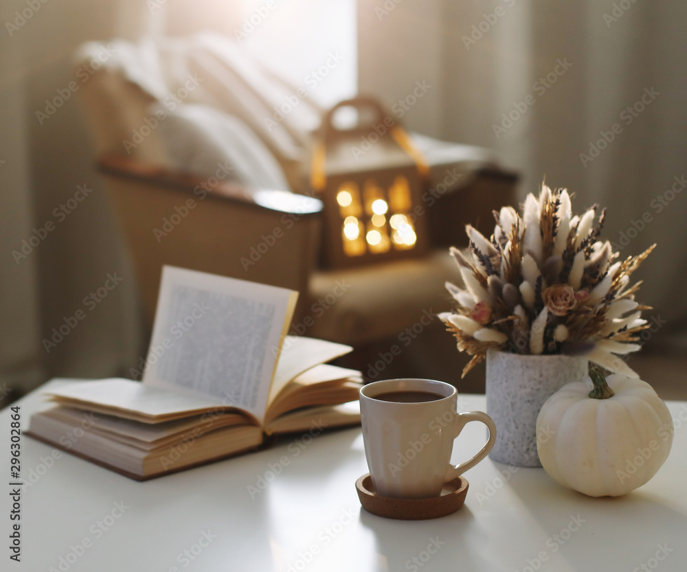 Obraz Autumn still life. Coffee cup, flowers, book and pumpkin. Hygge lifestyle, cozy autumn mood. Flat lay, Happy thanksgiving  fototapeta, plakat
