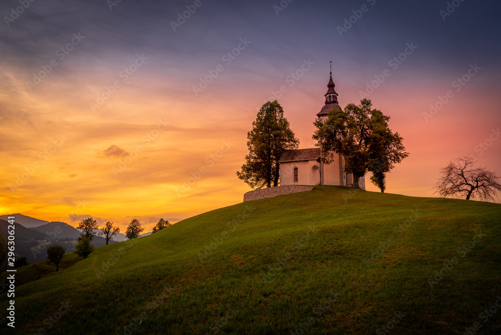 Fototapety, obrazy: Colorful sunset over mountains with church on the hill in Slovenia