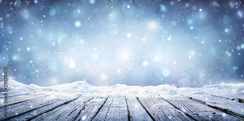 Obraz Winter Table - Snowy Plank With Snowfall In The Cold Sky - fototapety do salonu