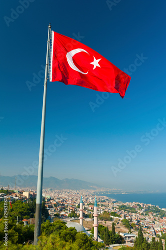 View at Izmir city from a hill above and a flag