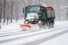 Snowplow Truck At Work Of Clea...
