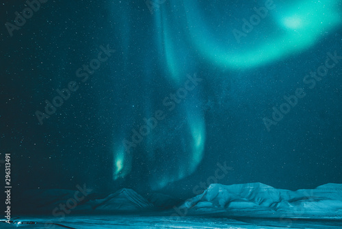 Cadres-photo bureau Aurore polaire The polar arctic Northern lights hunting aurora borealis sky star in Norway travel photographer Svalbard in Longyearbyen city the moon mountains