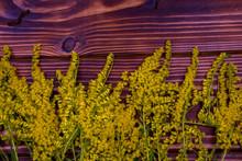 Yellow Grass On A Wooden Backg...