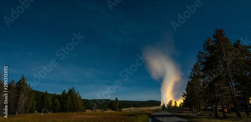 Fototapeta Eruption of Old Faithful geyser at Yellowstone National Park at night