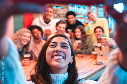 Fototapeta Happy friends taking a group selfie at pub obraz