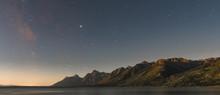 Dawn Breaks Over Starry Sky And Tetons Range