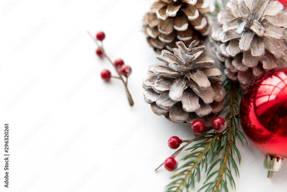 Fototapety, obrazy: winter holidays, new year and decorations concept - red christmas balls and fir branches with pine cones on white background