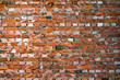 Leinwanddruck Bild - Old brick wall. Multi-colored brickwork with wide concrete seams in the loft style.