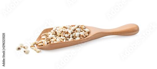Fényképezés  Grains useful of job's tears on wood spoon isolated on white