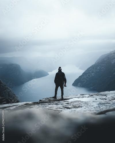 Person looking into the distatant fjord preikestolen norway - 296325850