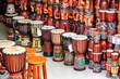 Leinwanddruck Bild - Wide range of colorful djembe drums at souvenir shop