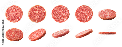 Valokuva Top and side views of smoked salami sausage slices isolated on white background