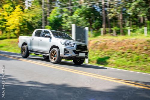Obraz Blurry speedy movement of pickup truck driving on road - fototapety do salonu