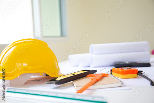 Fotomural  Desk of Architectural working project in construction site,With drawing equipment concept