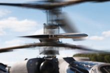 Closeup Of Helicopter Rotor Blades In Motion Against The Blue Sky