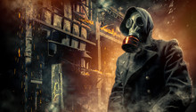 Man In A Gas Mask On An Industrial Background