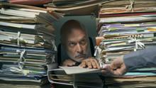 Creepy Office Clerk Overloaded With Paperwork