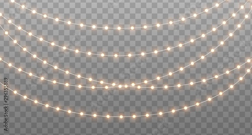 Fototapeta Christmas garland isolated on transparent background. Glowing yellow light bulbs with sparkles. Xmas, New Year, wedding or Birthday decor. Party event decoration. Winter holiday season element. obraz