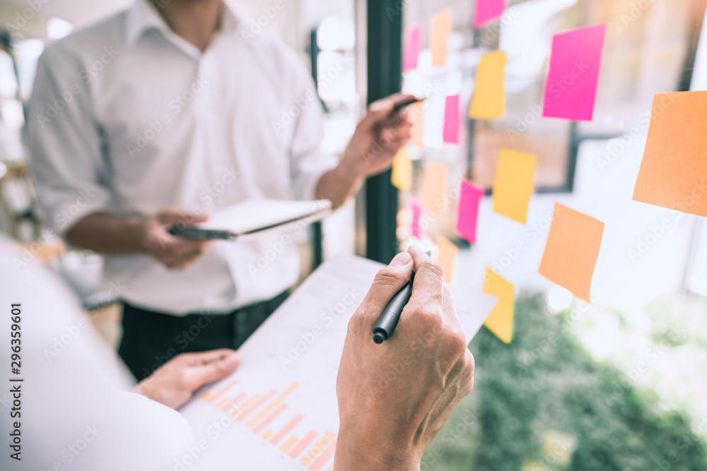 Fototapety, obrazy: Business people meeting at office and use sticky notes on glass wall in office, diverse employees people group planning work together brainstorm strategy.