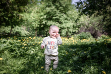 Portrait Of Cute Baby Boy In The Park