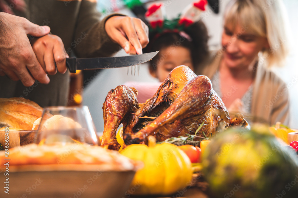 Fototapety, obrazy: Thanksgiving Celebration Tradition Family Dinner Concept.family having holiday dinner and cutting turkey.Young black adult woman and her daughter happy..