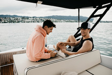 Happy Friends On A Boat Trip On A Lake