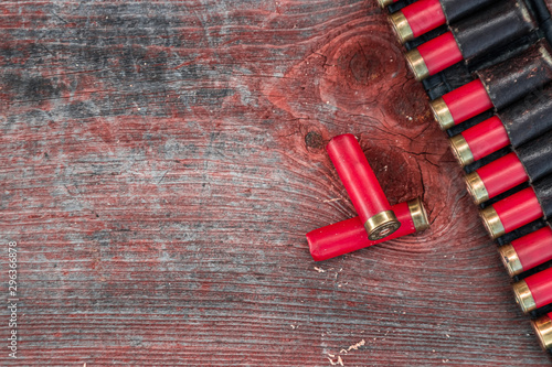 Hunting cartridges in patronage are lying on a wooden table close-up Wallpaper Mural
