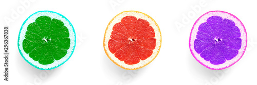 Fotografía  Abstract colored halves of grapefruit, violet, red, green on a white background, border