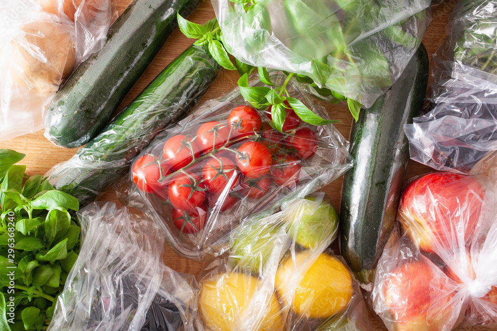 Fototapeta single use plastic waste issue. fruits and vegetables in plastic bags