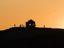 Silhouettes Of People On Top O...