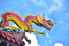 Dragon On Roof Of Chinese Temp...