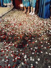 Floor Covered With Red And White Confetti