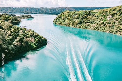 Boat wake in river
