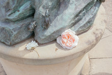 White And Pink Flowers In Foot Of Monument With Mice Figurines