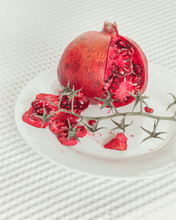 Pomegranate Fruit On White Plate
