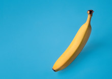 Banana And Its Shadow On Blue ...