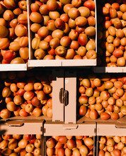 Overhead View Of Apricots In Cardboard Boxes