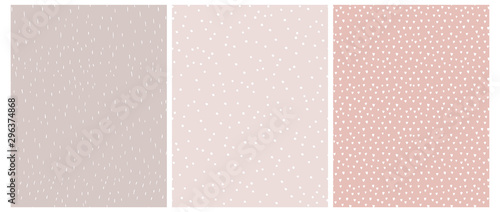 3 Cute Abstract Geometric Vector Patterns. White, Pink and Beige Color Design. Brushed Raindrops on a Light Brown Background.Irregular White Dots on a Light Pink. Romantic Print With White Tiny Hearts