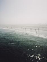 People On Foggy Beach