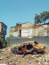 Destroyed Car On Junk Heap, Is...