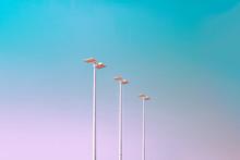 Light Poles Against Clear Sky