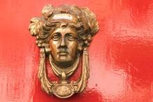 Valletta, Malta, August 2019. Old Bronze Doorknob On A Red Background.